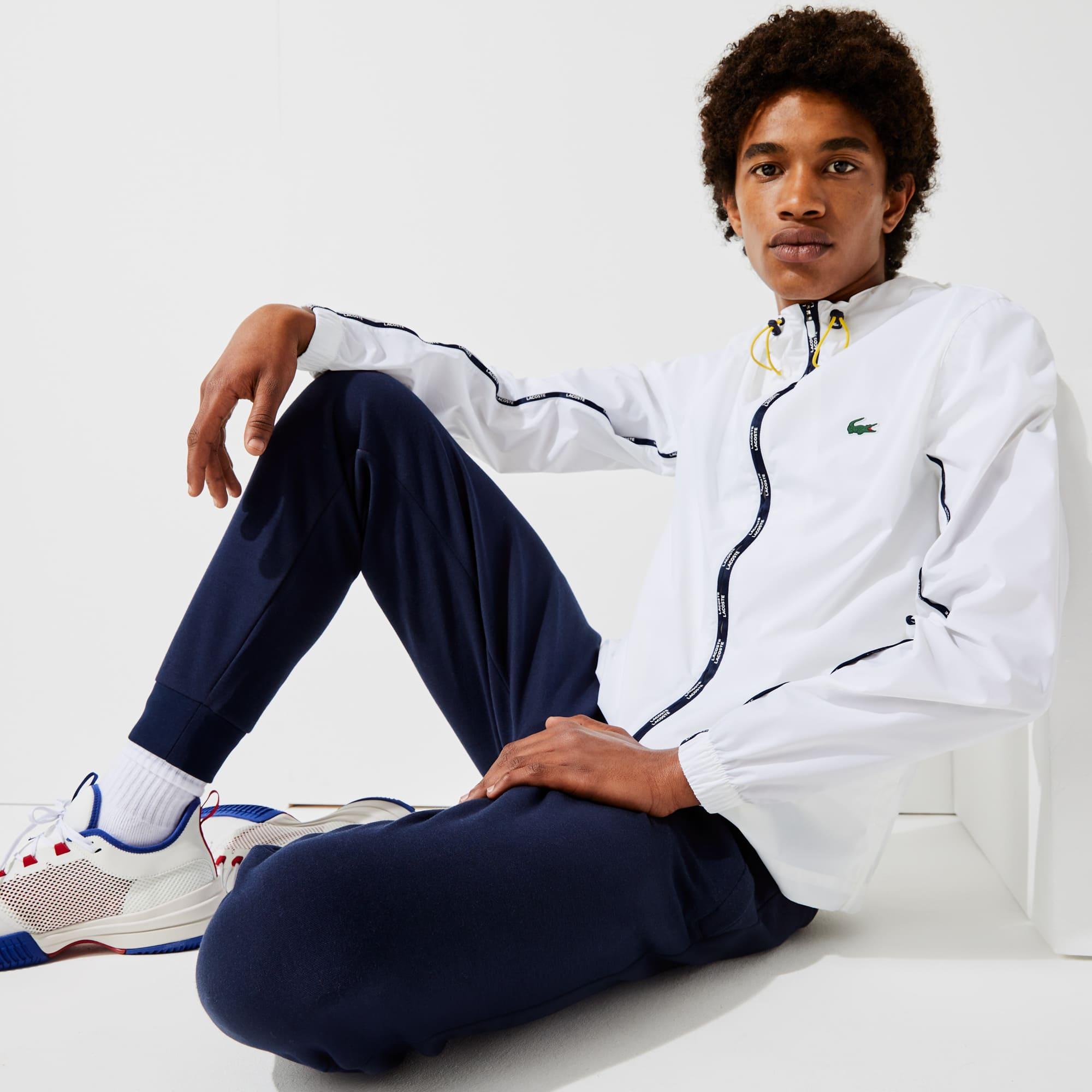 라코스테 Lacoste Men's SPORT Light Packable Water-Resistant Zip Jacket,White / Navy Blue / Yellow 282