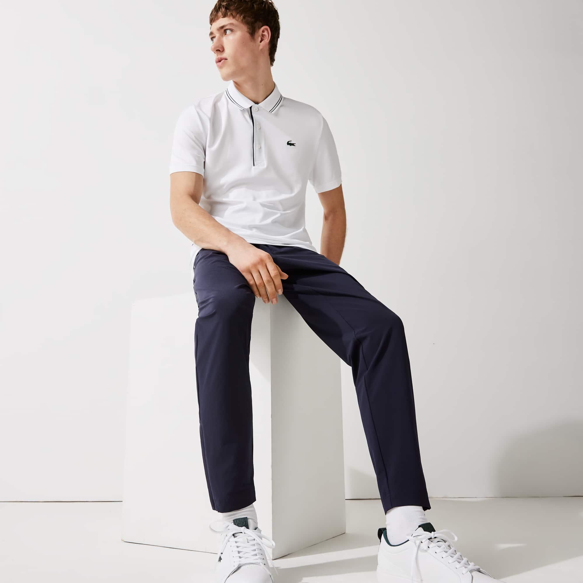 라코스테 Lacoste Men's SPORT Lightweight Stretch Chino Golf Pants,Navy Blue / White 525