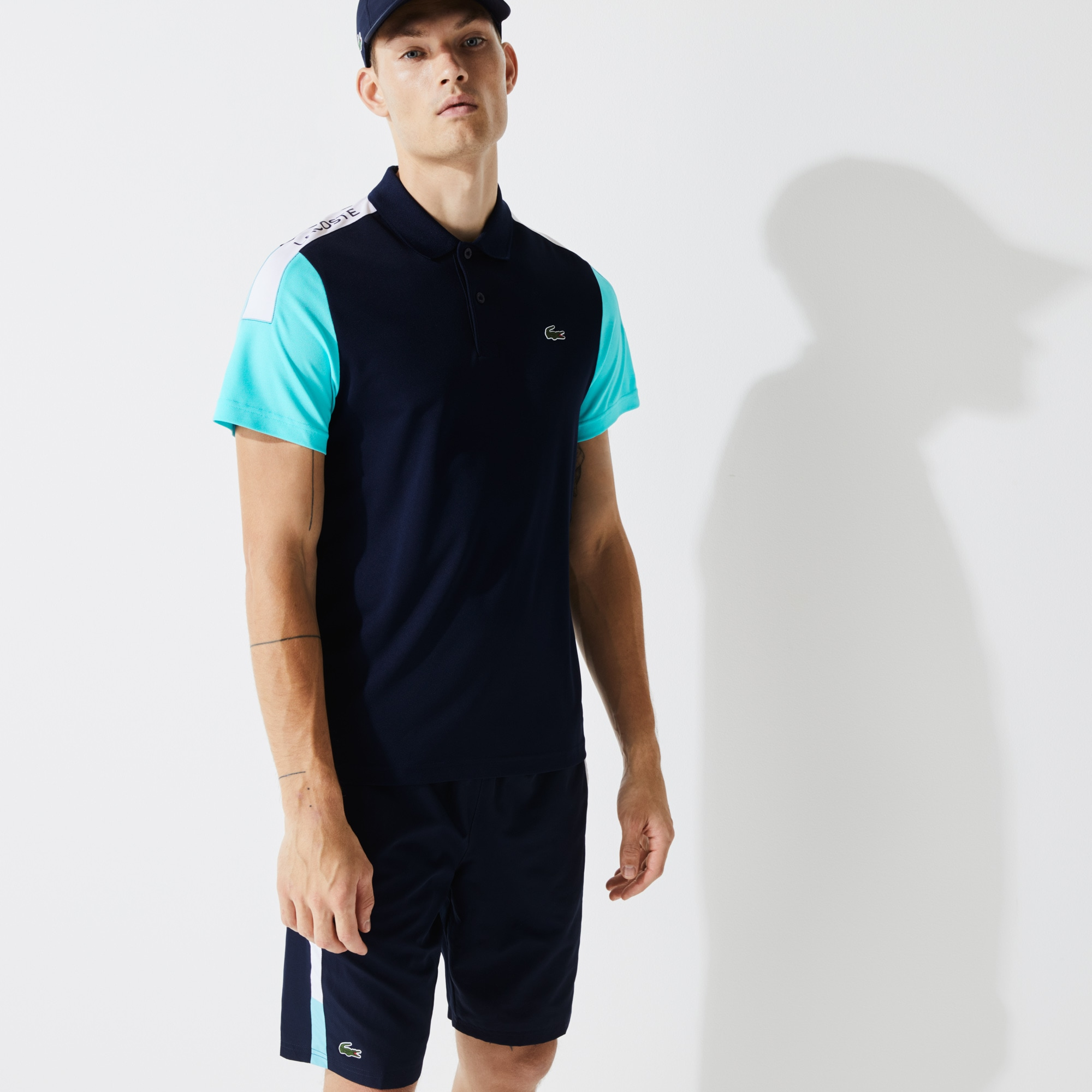 라코스테 스포츠 Lacoste Mens SPORT Breathable Resistant Pique Polo Shirt,Navy Blue / Turquoise / White - 2YE (Selected colo